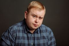Skeptic, unsure, uncertain, doubts concept. Fat guy looking sceptical Stock Image