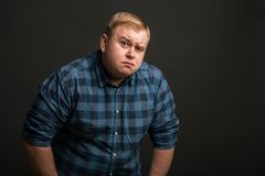 Skeptic, unsure, uncertain, doubts concept. Fat guy looking sceptical Royalty Free Stock Photography