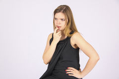 Skeptic Woman in black  dress. Stock Photo