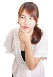 Skeptic woman portrait. Portrait of a skeptical young and unapproachable Asian woman in chaste lace outfit holding a hand on her chin and looking fishy and Stock Photography