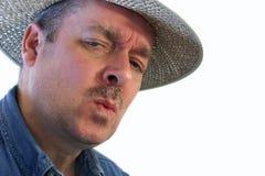 Skeptical Attitude. A country man wearing a straw hat has a skeptical attitude Stock Photos