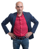 Skeptical bald man looking at camera. Isolated Stock Image