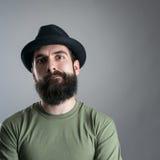 Skeptical bearded hipster staring at camera. Stock Image