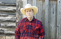 Skeptical Cowboy. Handsome cowboy or rancher with a skeptical expression Stock Photos