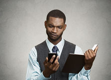Skeptical executive reading breaking news on smart phone Stock Photography