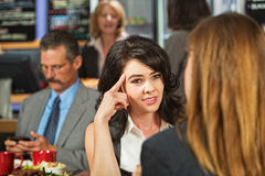 Skeptical Female in Cafe Stock Photography