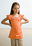 Skeptical girl with hands on hips Stock Image