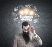 Skeptical mężczyzna i strategii biznesowej ikony Zdjęcia Royalty Free