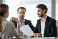 Skeptical male hr managers unconvinced about hiring female candidate royalty free stock photos