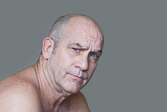 Skeptical Man. Handsome middle-aged man with a skeptical expression Stock Photos