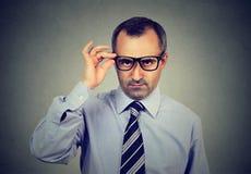 Skeptical mature business man looking at camera Royalty Free Stock Photo