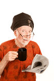 Skeptical New Age Man with Cioffee. Skeptical New Age Man with Coffe and Newspaper Stock Photos