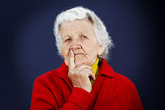 Skeptical old elderly woman Royalty Free Stock Photo
