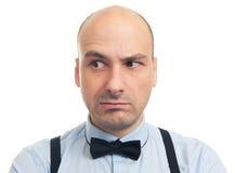 Skeptical poważny łysy mężczyzna obrazy stock