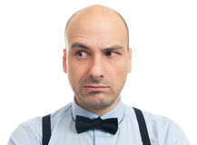 Skeptical serious bald man Stock Images