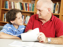 Skeptical Student. School boy listens to his teacher (or dad) with a skeptical expression Stock Photos