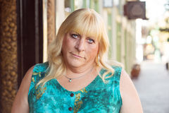 Skeptical transgender woman in green dress Stock Photos