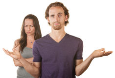 Skeptical Wife and Hopeless Woman. Hopeless men with hands up and suspicious wife Stock Images