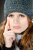 Skeptical winter girl Royalty Free Stock Photos