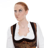 Skeptical woman in dirndl - Evil Eye. Skeptical woman in Dirndl isolated on white stock image