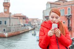 Skeptical woman reading bad news on smart phone royalty free stock photography