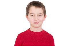 Skeptical young boy with a disbelieving expression. Looking thoughtfully at the camera as he assesses the situation, isolated on white Royalty Free Stock Photos