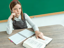 Skeptical young girl looking carefully suspicious, skepticism on face. Photo of teen school girl, creative concept with Back to school theme stock photo