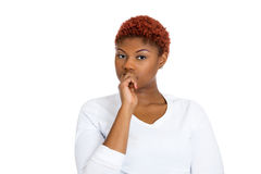 Skeptical young woman looking suspicious Stock Images