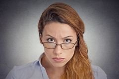 Skepticism. Angry grumpy doubtful woman looking at you. Camera isolated on grey wall background. Negative human emotion facial expression feeling body language stock images