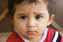 Skepticism, Closeup up portrait headshot suspicious, cautious ch. Closeup up portrait headshot suspicious, cautious child boy looking at the camera. disbelief stock images