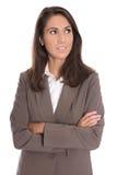 Skeptisch lokalisierte Geschäftsfrau im braunen Blazer, der Seite schaut Stockfoto