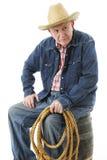 Skeptischer älterer Cowboy Stockfotografie