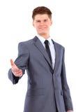 affärsman som ger dig en räckaskaka Fotografering för Bildbyråer