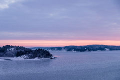 Skerries of Sweden covered by ice and snow. On winter morning before sunrise Stock Photography