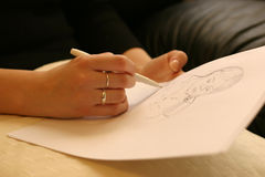 Sketch. Close shot of artist's hands sketching royalty free stock photography