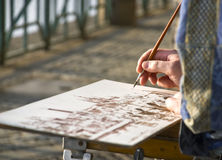 The sketch. The artist makes the sketch on quay in the center of Prague Stock Images