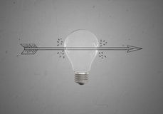 Sketch of arrow piercing light bulb Stock Photography
