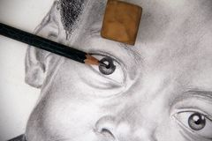 Sketch art concept. Closeup on the eye of a lead pencil drawing. Image is a self portrait I drew from an old photo of myself Royalty Free Stock Image