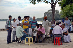 Sketch Artists at Sukhna Lake. Tourists getting their portrait made by pencil sketch portrait artists at sukhna lake, Chandigarh, India Royalty Free Stock Photos