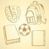 Sketch backpack, watercolors, football ball, book and notebook Royalty Free Stock Image