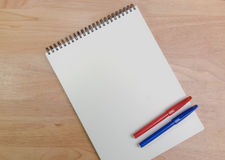 Sketch book. Sketch book with blue and red magic pen on pine wood background Stock Photography