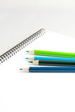 Sketch book with colored pencils Stock Photo