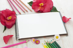 Sketch book, flowers and color pencils Stock Photos