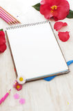 Sketch book, flowers and color pencils Royalty Free Stock Photography