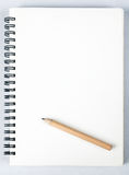 Sketch book. With pencil on white background Royalty Free Stock Image