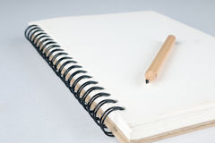 Sketch book with pencil Stock Images