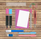 Sketch book and school or office tools on wood background Stock Photography