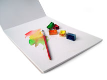 Sketch book and water colors Stock Photography