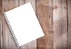Sketch book on wooden plank. Blank sketch book or notebook on wooden plank for background stock photos