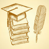 Sketch books. With graduation cap on the top and feather pen Royalty Free Stock Images